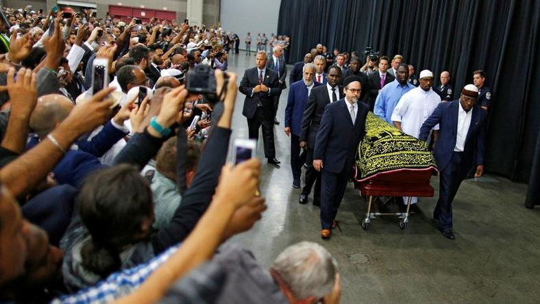 Worshipers and well-wishers take photographs as the casket with the body of the late boxing champion Muhammad Ali is brought for his jenazah, an Islamic funeral prayer, in Louisville, Kentucky, U.S. June 9, 2016.