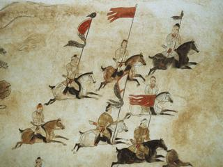 Murals picturing soldiers on horseback on the wall of the