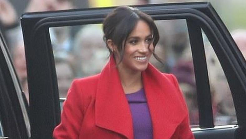 Meghan Markle is a vision in a cromson coat for official royal engagment