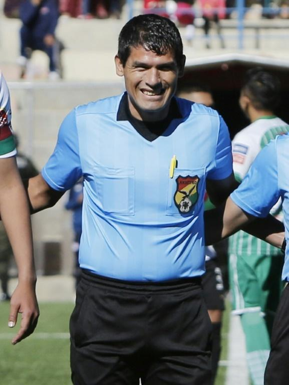 Bolivian referee Victor Hugo Hurtado poses at the start the match