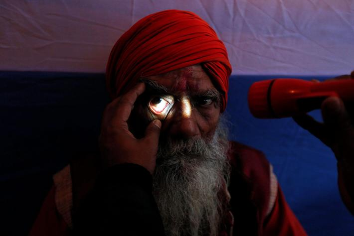 A Sadhu or a Hindu holy man undergoes an eye examination at a free eye-care camp organised by social