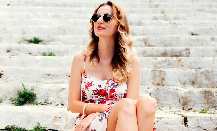 Beauty young woman in dress sitting on steps
