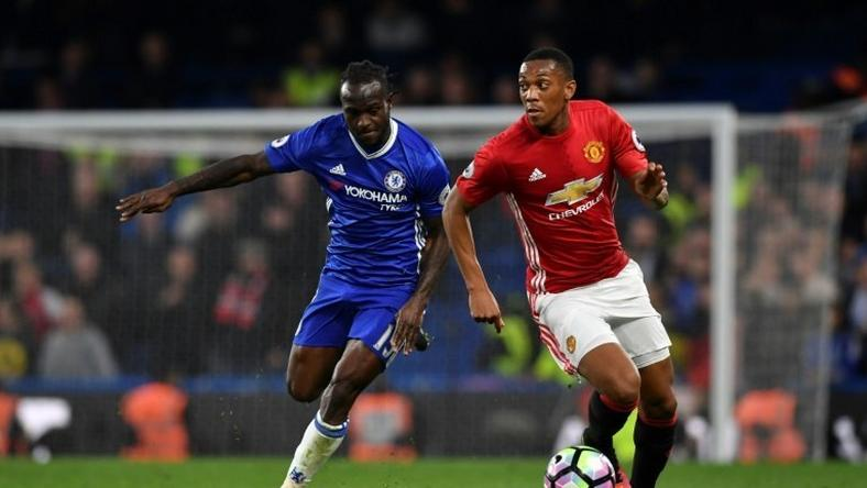 Manchester United's striker Anthony Martial (R) takes on Chelsea's midfielder Victor Moses (L) during the English Premier League football match October 23, 2016