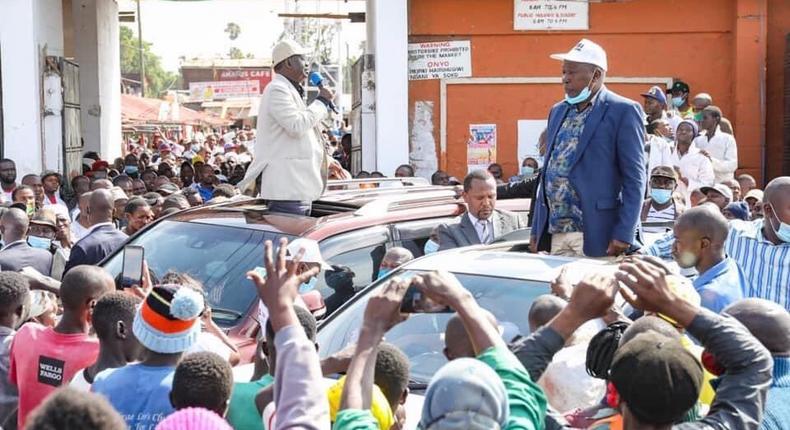 Former Prime Minister Raila Odinga and nominated MP Maina Kamanda during a tour of Burma Market, Nairobi