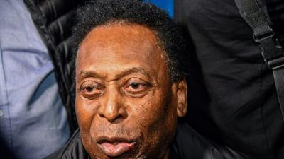 Pele playing cards, smiling after surgery: daughter