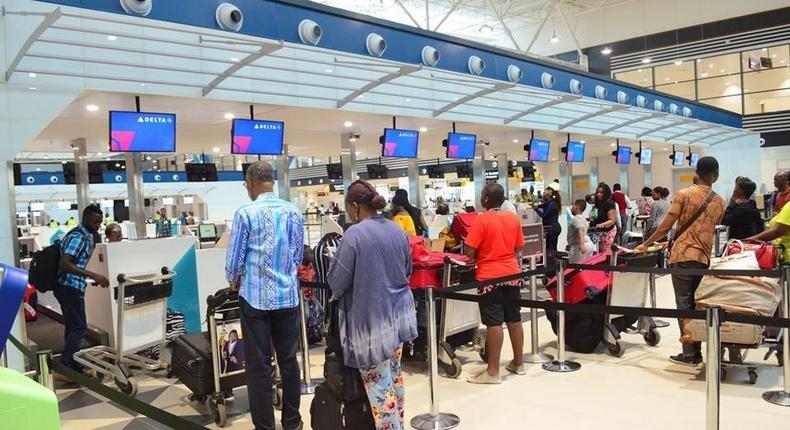 Passengers at Kotoka Airport Ghana (kuulpeeps)