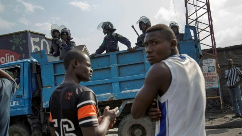 Police patrol in the neighbourhood of Majengo after people attempted to block the road with rocks, in Goma, eastern Democratic Republic of the Congo, on December 19, 2016