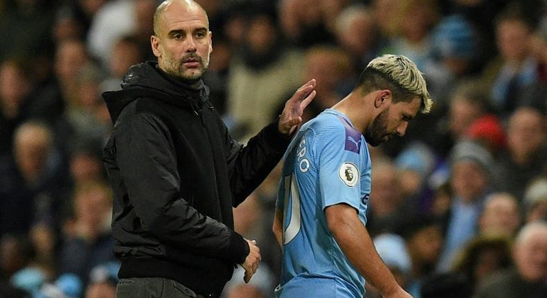 Pep Guardiola (left) says Manchester City will need to sign a long-term successor to Sergio Aguero Creator: Oli SCARFF