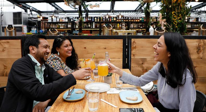 Customers toast on the Eataly Flatiron Rooftop in New York City on April 15, 2021.