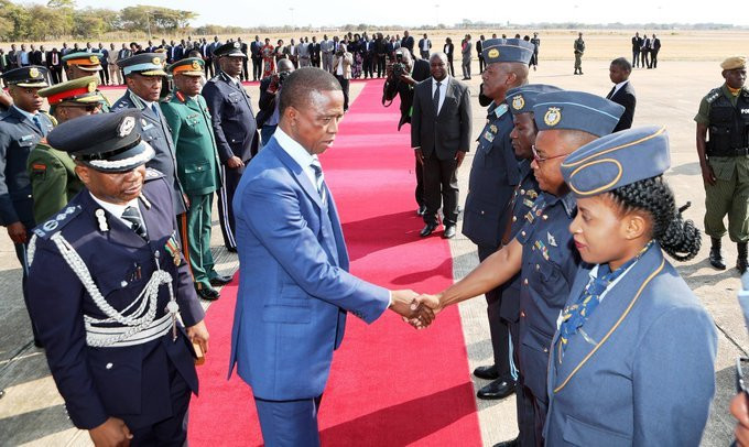 PRESIDENT Edga rCLungu greets the Zambia Airforce crew shortly before departure for Japan where he has gone to attend the 7th Tokyo International Conference on African Development (TICAD), at ZAF base on Monday, 26th August, 2019, Eddie Mwanaleza/State House