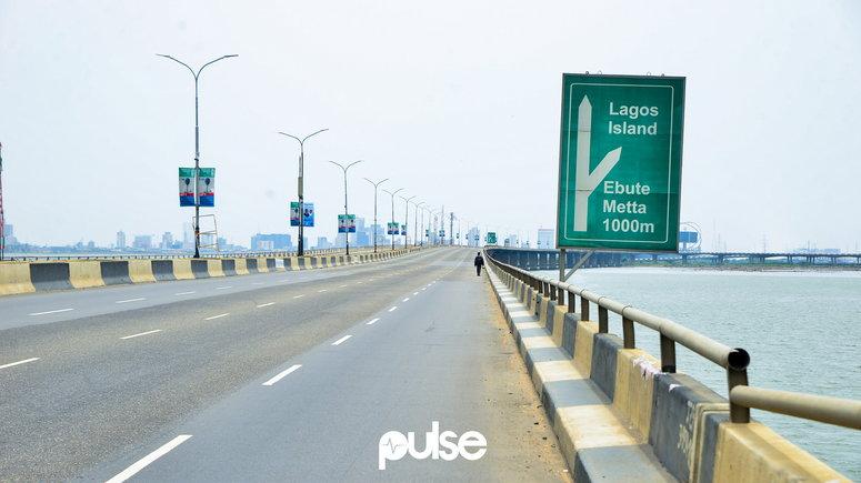 A lone man walks on Third Mainland Bridge (Pulse)