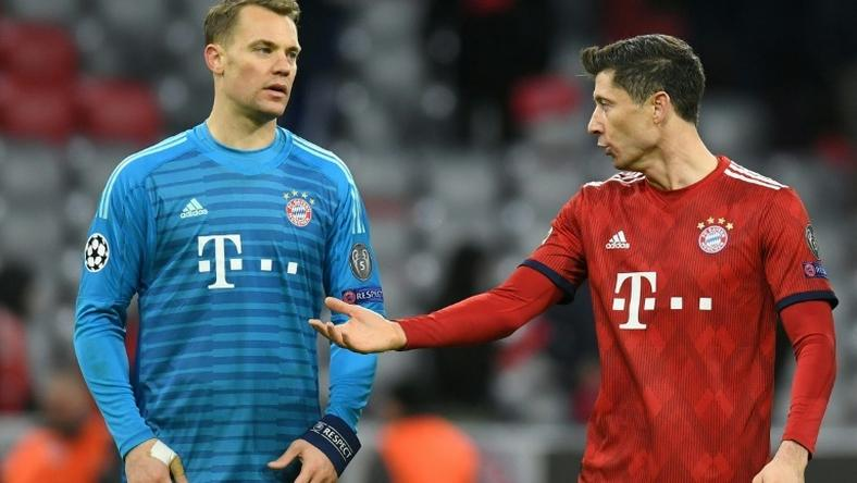 Bayern Munich's Germany goalkeeper Manuel Neuer and Polish forward Robert Lewandowski count the cost of their Champions League exit