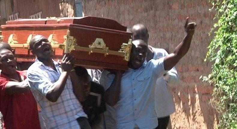 People carrying a coffin