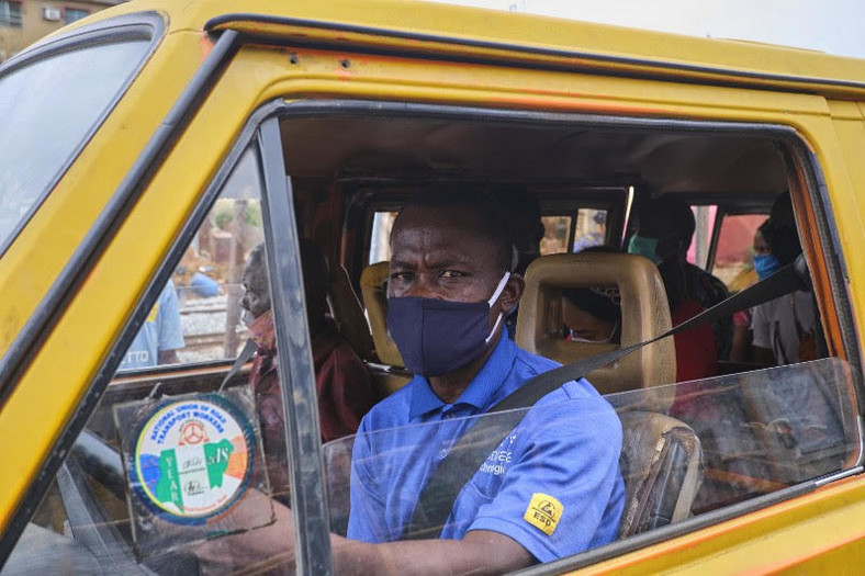 Lagos bus driver gets his mask on (Pulse)
