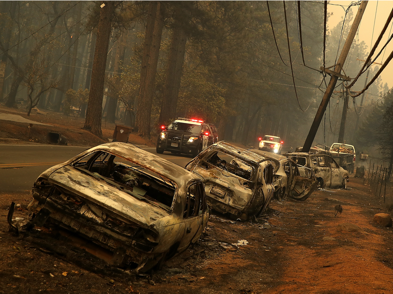 A line of burned out abandoned cars sit on the road after the Camp Fire moved through Paradise, California on November 9, 2018.