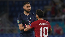 On the way out: After Turkey's  Euro 2020, which opened with a loss to Italy, ended early, Hakan Calhanoglu announced he was leaving AC Milan, Italy goalkeeper Gianluigi Donnarumma may soon follow Creator: ALBERTO LINGRIA