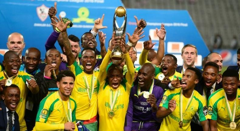 Mamelodi Sundowns' players celebrate after winning the CAF Champions League competition following their final match against Egypt's Zamalek, at the Borg el-Arab Stadium near Alexandria, on October 23, 2016