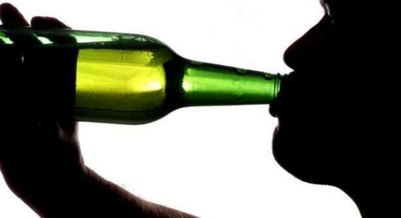 Man drinking alcohol (for illustrative purposes)