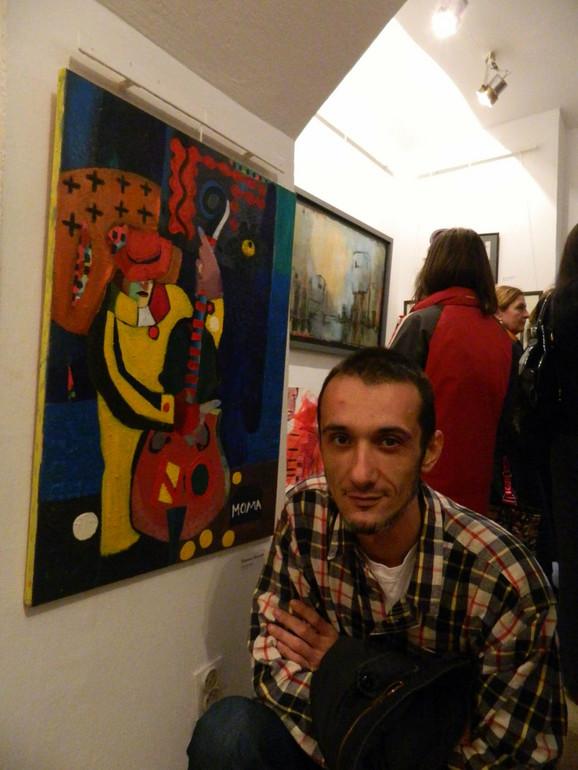 Momčilo Moma Bjeković akademski slikar sa njegovom slikom