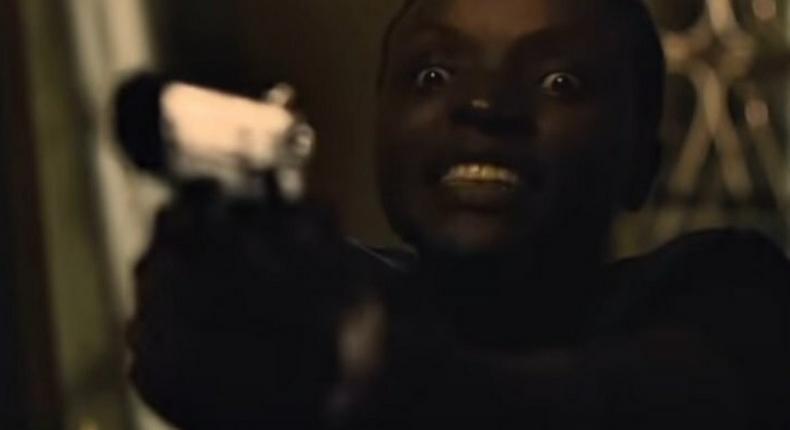 Kevin wielding a gun in new show K.E.R.U