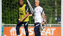 France striker Kylian Mbappe (L) and coach Didier Deschamps (R) prepare for Tuesday's Euro 2020 clash with Germany Creator: FRANCK FIFE