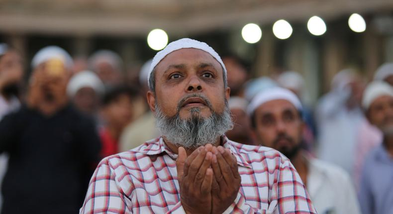 A Muslim man prays as he and others assemble to spot the crescent moon, on the eve of the holy fasting month of Ramadan at a mosque in Ahmedabad, India, May 6, 2019.