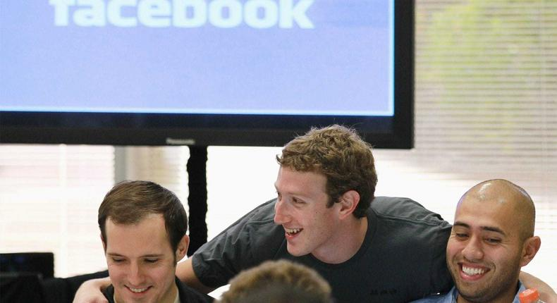 Facebook founder and CEO Mark Zuckerberg greets Facebook employees before speaking at a news conference at Facebook headquarters on on October 6, 2010.