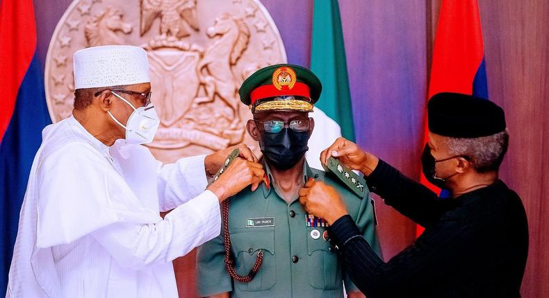 President Muhammadu Buhari and Vice President Yemi Osinbajo decorate the Chief of Defence Staff, Gen. Lucky Irabor with his new rank. [Presidency]