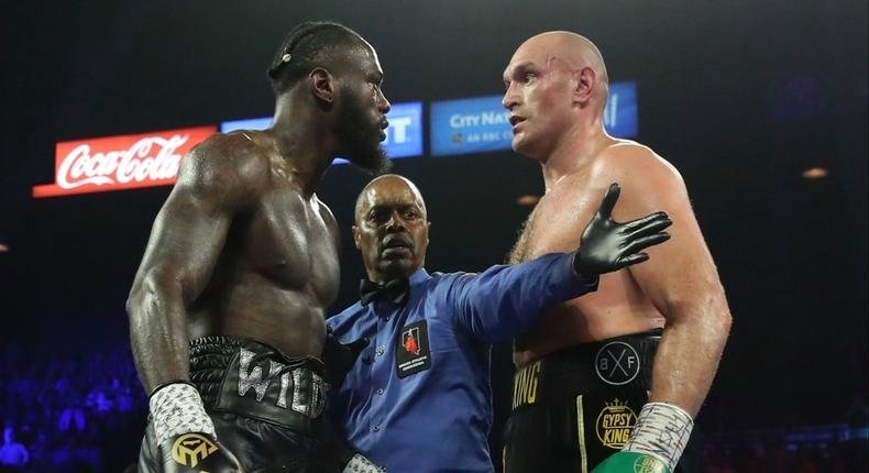American boxer Deontay Wilder in the ring with British boxer Tyson Fury