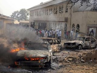 File photo shows a car burning at the scene of a Boko Haram bomb explosion at St. Theresa Catholic C