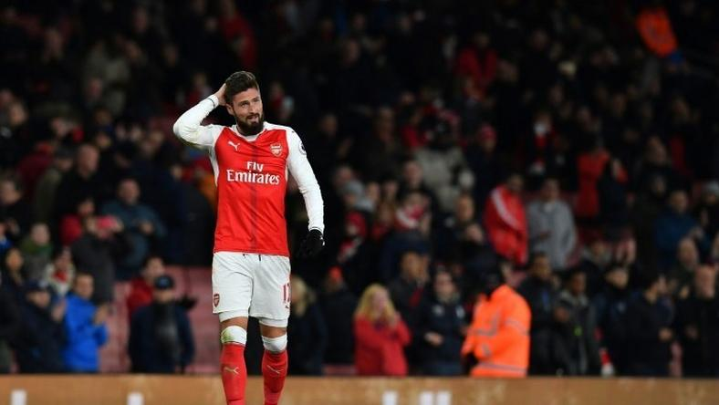 Arsenal's French striker Olivier Giroud gestures on the pitch after the English Premier League football match between Arsenal and Bournemouth at the Emirates Stadium in London on November 27, 2016