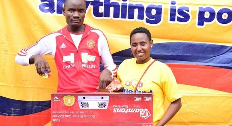 Kevin Musevi wins gas burner in Changamka na BB Ushinde promotion during Kisumu road show