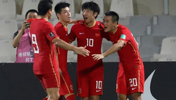 Chinese players celebrate beating  Syria at the Sharjah Football Stadium to secure their place in the final qualifying round for Qatar 2022 Creator: Karim SAHIB