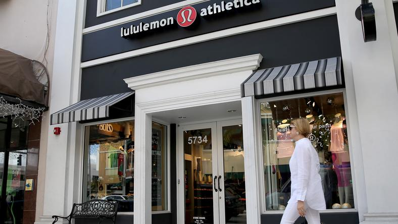 A woman walks past a Lululemon Athletica store in Miami, Florida in 2013.