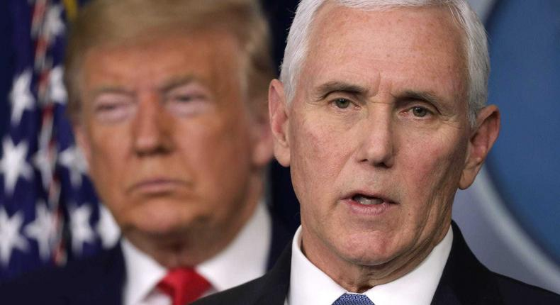 President Donald Trump listens as Vice President Mike Pence speaks at a coronavirus briefing in February 2020.