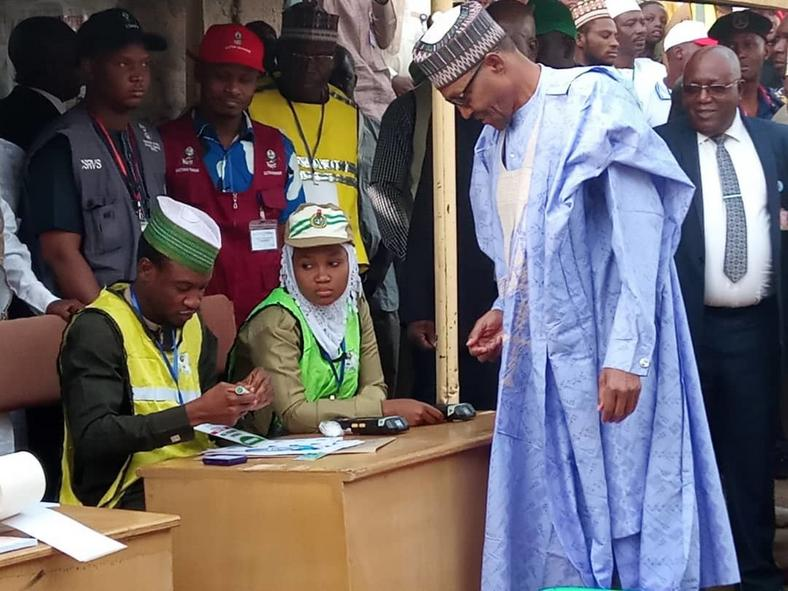Image result for Buhari at his polling unit