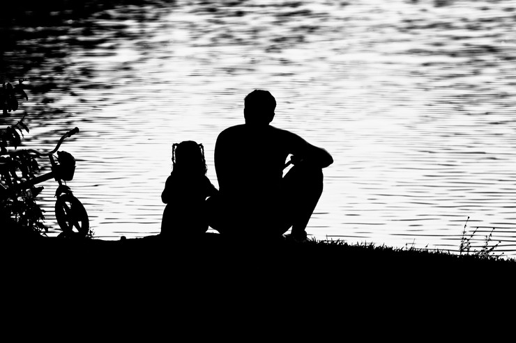 stock-photo-father-and-daughter-sitting-by-a-lake-father-day-153959978