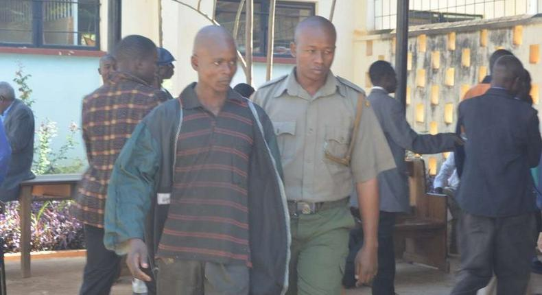 Kevin Simiyu is led outside Bungoma law court he was jailed for fifteen months on Thursday, March, 2017 after pleading guilty to performing sexual acts with a hen.