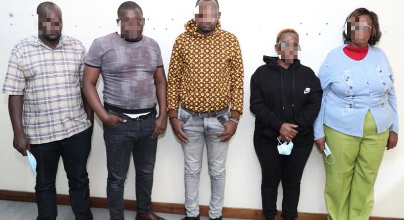 Suspects charged with 12 counts of using the late Amos Ngata Muiruri's details to steal