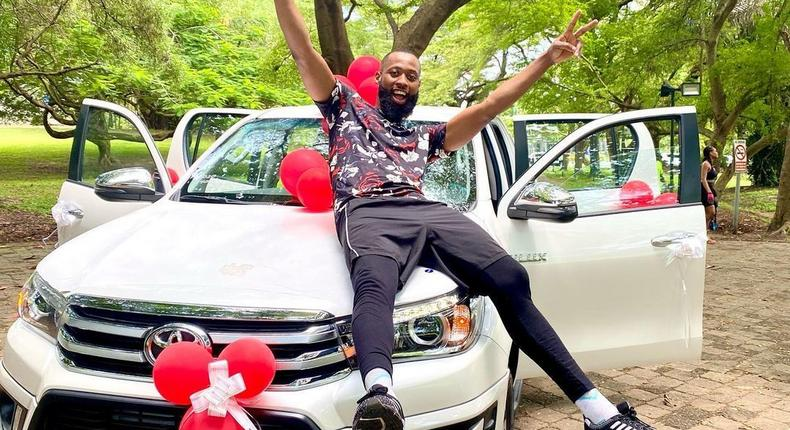 Reality TV star Tochi and his new truck [Instagram/TochiOfficial]