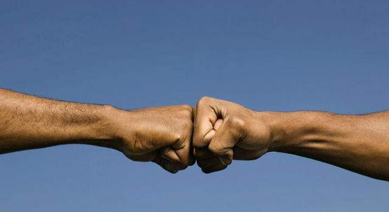 A fist bump is the way to go as scientists say it can protect yourself against various infections including the coronavirus (heavy)