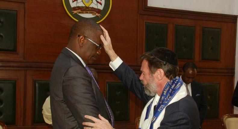 Messianic Rabbi Kirt Schneider of the Africa Divine Ministry prays for Nairobi Governor Evans Kidero at City Hall, March 21, 2017.