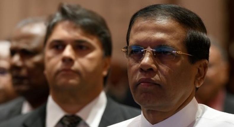 Sri Lanka's President Maithripala Sirisena (right) pictured in Colombo on December 19, 2016