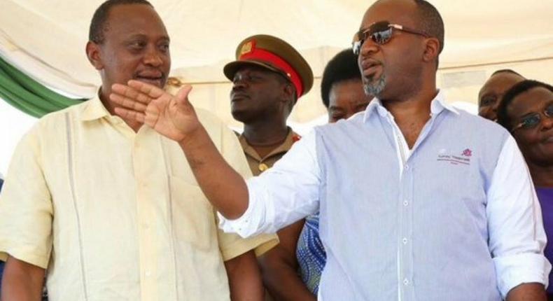 President Uhuru Kenyatta with Mombasa governor Hassan Joho at Shika Adabu grounds Likoni, where Uhuru was issuing title deeds to squatters of the controversial 930-acre Waitiki farm.