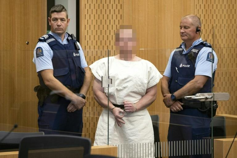 Brenton Tarrant, the accused Christchurch shooter, makes a white power sign during his court appearance