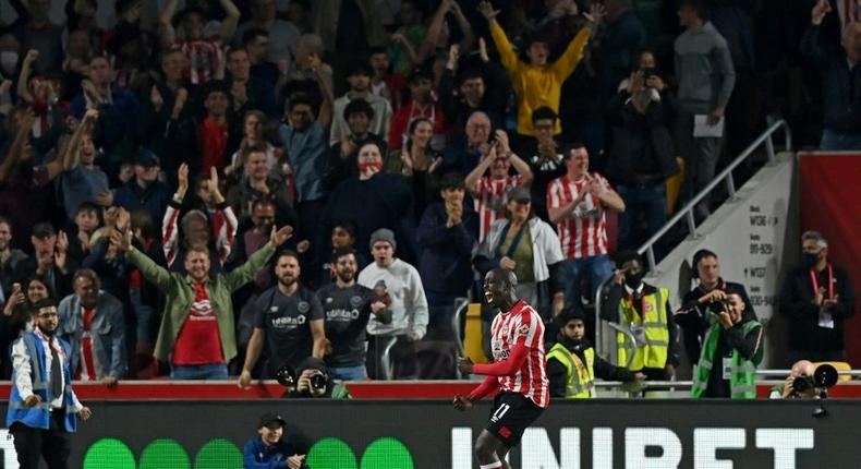 Yoane Wissa celebrates Brentford's late equaliser against Liverpool Creator: Glyn KIRK