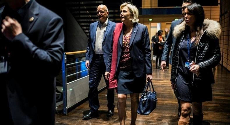 French presidential election candidate for the far-right Front National (FN) party Marine Le Pen (C) arrives at political rally to kick off her campaign next to her aide Catherine Griset (R) and bodyguard Thierry Legier (L) February 4, 2017