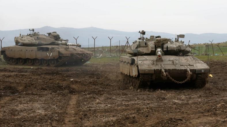 Israeli tanks deploy in the Israeli-annexed Golan Heights on January 20, 2019