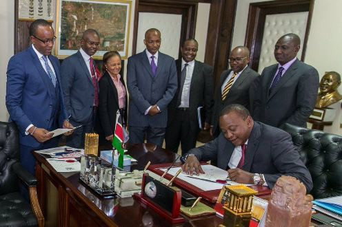 President Uhuru signing interest capping bill into law