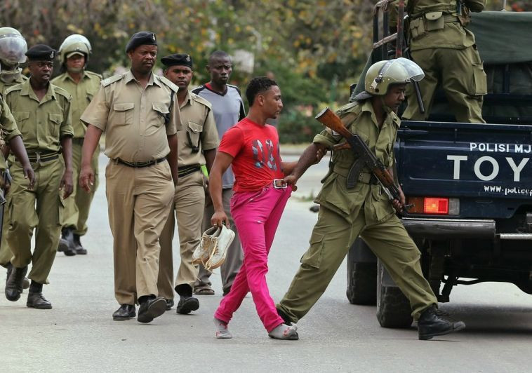 Tanzania Police arresting a civilian at a past event.